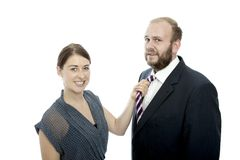 Young brunette woman and business man pull tie Stock Photography