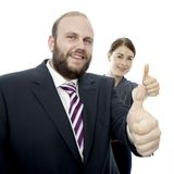 Young brunette woman and business man thumbs up Royalty Free Stock Image