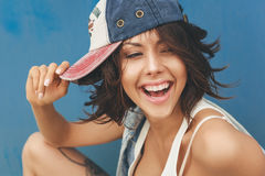 Young brunette woman in cap Stock Photos