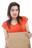Young brunette woman carrying a cardboard box Royalty Free Stock Photos