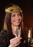 Young brunette woman with champagne glass Royalty Free Stock Photos