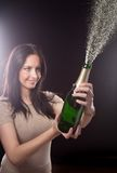 Young brunette woman with champagne glass Stock Photos