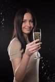 Young brunette woman with champagne glass Stock Images