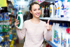 Young brunette woman choosing detergent Stock Image