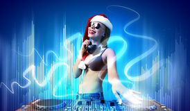Female dj in christmas wear Stock Images