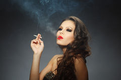 Young brunette woman with cigarette Stock Image