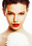 Young brunette woman close up isolated on white with big flower, spa girl concept Stock Photography