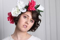 Young brunette woman with cmake-up and flower wreath royalty free stock image