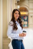 Young brunette woman with coffee Royalty Free Stock Images