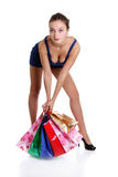Young brunette woman with colored bags Royalty Free Stock Images