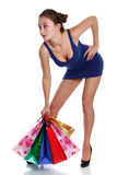 Young brunette woman with colored bags Stock Image