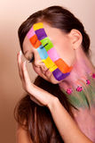 Young brunette woman with colorful makeup Stock Images