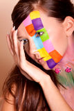 Young brunette woman with colorful makeup Stock Image