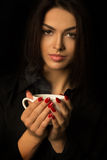 Young brunette woman with cup of coffee o Royalty Free Stock Images