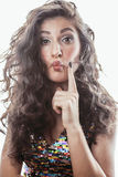Young brunette woman with curly hairstyle in fancy glamur dress isolated on white background gesturing emotional. Close up Stock Photo