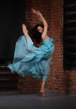 Young brunette woman dancing Royalty Free Stock Photography