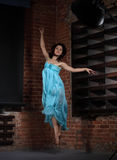 Young brunette woman dancing Stock Images