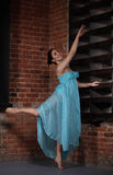 Young brunette woman dancing Stock Photo