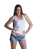 Young brunette woman in denim shorts and white top Stock Photography