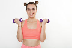 Young brunette woman doing dumbbell exercises isolated Stock Image