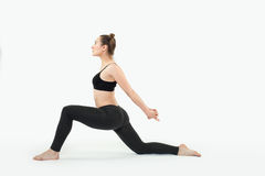 Young brunette woman doing pilates exercises isolated Royalty Free Stock Photos