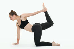 Young brunette woman doing pilates exercises isolated Stock Photo
