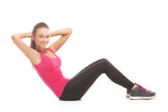Young brunette woman doing press exercises Stock Photo