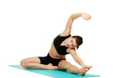 Young brunette woman doing stretches Stock Images
