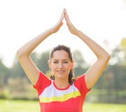 Young brunette woman doing yoga exercises. Young brunette woman doing yoga exercises in a autumn park Royalty Free Stock Images