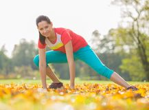 Young brunette woman doing yoga exercises. Stock Photo