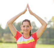 Young brunette woman doing yoga exercises. Young brunette woman doing yoga exercises in a autumn park Stock Photography