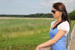 Young brunette woman dreaming outdoor Stock Photography