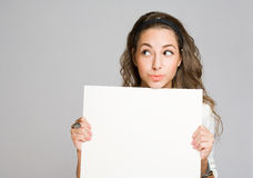 Young brunette woman with empty banner. Stock Images