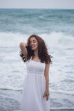Portrait of young brunette woman enjoying sea storm Royalty Free Stock Photography