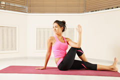 Young brunette woman exercising yoga Stock Photos