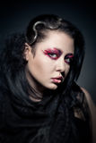 Young brunette woman with fashion makeup on dark Royalty Free Stock Photo
