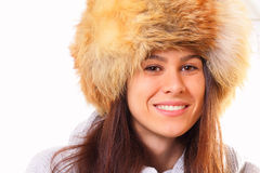 Young brunette woman in a fur hat. Young and beautiful brunette woman in a fur hat Stock Photos