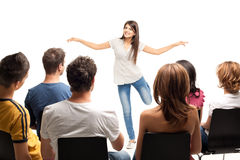 Young brunette woman gesturing at crowd Stock Photos