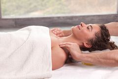 Young brunette woman getting massage stock image