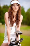 Young brunette woman with golf equpment Royalty Free Stock Photo