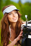 Young brunette woman with golf equpment. Young brunette woman with golf equipment Stock Photo
