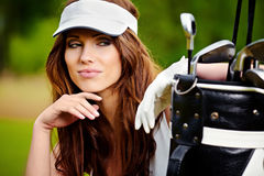 Young brunette woman with golf equpment. Young brunette woman with golf equipment Stock Photography