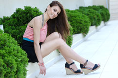 Young brunette woman on the green grass Stock Images