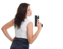 Young brunette woman with gun isolated on white Stock Photography