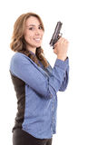 Young brunette woman with gun isolated on white Stock Image