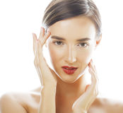 Young brunette woman with hands on face isolated Royalty Free Stock Photos