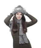 Young brunette woman in hat, gloves and scarf on white. Background royalty free stock image