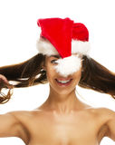 Young brunette woman having fun with santas hat Stock Photos