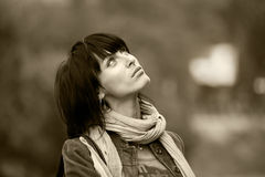 Young brunette woman having a walk in park Royalty Free Stock Images