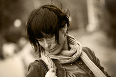 Young brunette woman having a walk in park Royalty Free Stock Photo